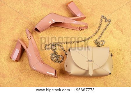 Pair Of Shoes In Pink Colour And Beige Handbag
