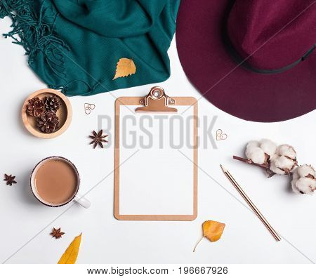 Clipboard mock-up on the white background with autumn related accessories and objects