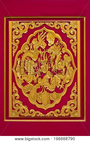 golden dragon on red background in chinese temple, Thailand