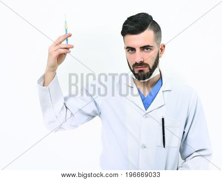 Medicine And Recovery Idea. Doctor With Beard Holds Syringe