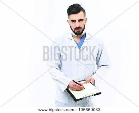 Treatment And Ambulance Service Concept. Doctor With Beard Writes Prescriptions