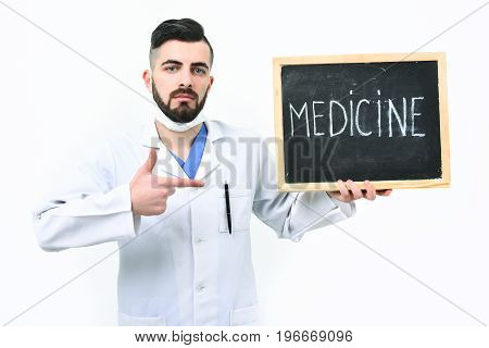 Treatment And Recovery Concept. Doctor With Beard Holds Word Medicine