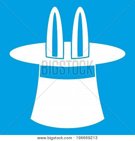 Rabbit ears appearing from a top magic hat icon white isolated on blue background vector illustration