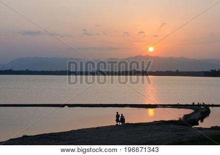 Taungtaman Lake at sunrise from the teakwood bridge.
