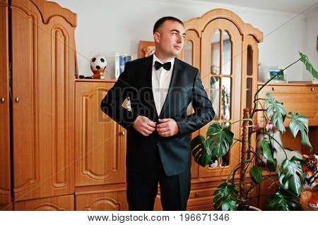 Handsome Groom Dressing Up In His Room For His Wedding Ceremony.