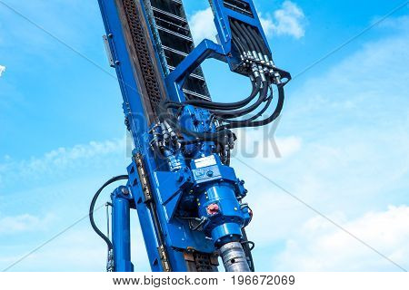 part of hydraulic drilling rig in sky with clouds