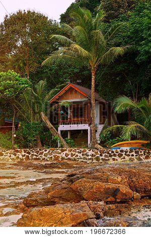 RANONG PROVINCE THAILAND - DECEMBER 24 2016: Single hotel bungalow on border of jungle and sand beach