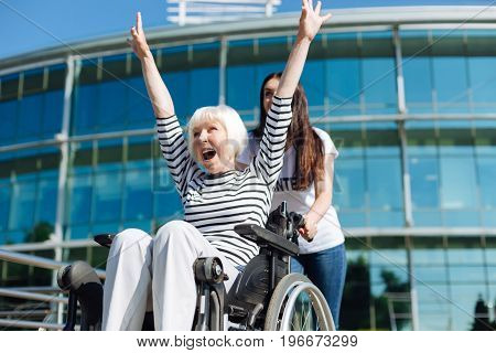 Enjoying every day. Stunning energetic elderly lady living her life to the fullest while young lady who working as a volunteer assisting her on a daily basis