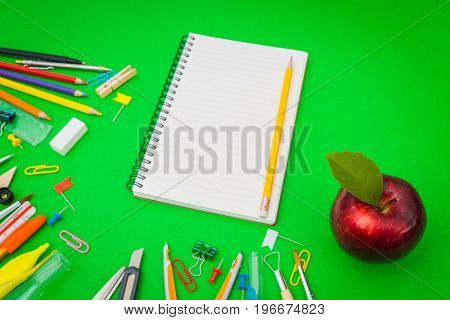 School supplies on Green chalkboard