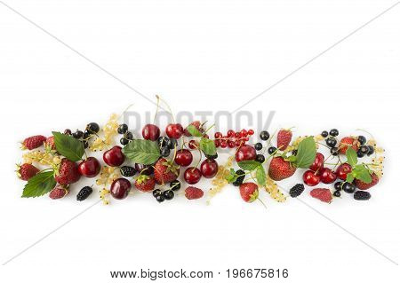 Ripe strawberries redcurrants blackcurrants mulberries raspberries and cherries on white background. Berries at border of image with copy space for text. Background berries. Various fresh summer berries.