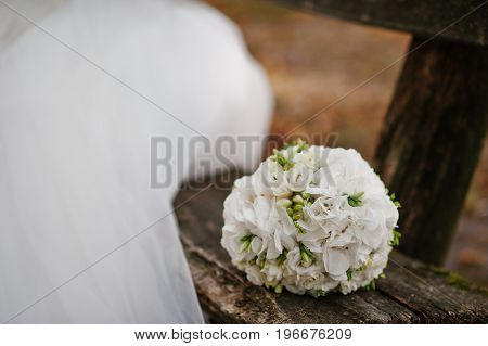 Close-up Photo Of An Isolated Beautiful Wedding Bouquet Made Of White Roses And Light Green Freesias