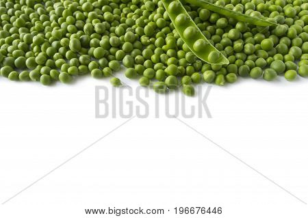 Fresh green pea in the pod on white background. Green pea at border of image with copy space for text