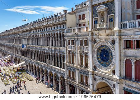 Venice, Italy - May 21, 2017: Piazza San Marco or St Mark's Square with ancient Clock tower (Torre dell'Orologio). This is the main square of Venice.