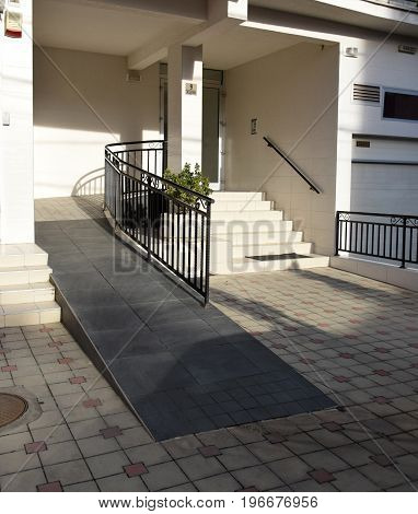 A ramp for a wheelchair on the entrance in a residential building