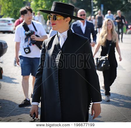 FLORENCE- 13 June 2017 Woman on the street during the Pitti