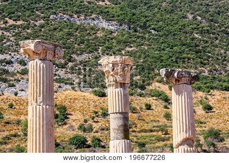 Ruins of columns in ancient city of Ephesus in Turkey on sunny day