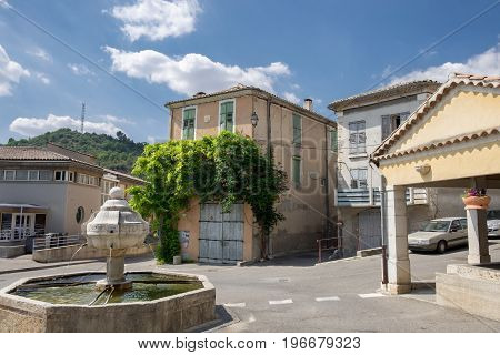 Ansient fountain on main square in Riez. Alpes-de-Haute-Provence region France