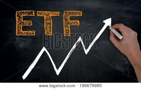 Etf And Graph Is Written By Hand On Blackboard