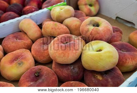 Saturn Peaches or Donut peaches sold at local city market. Provence. France