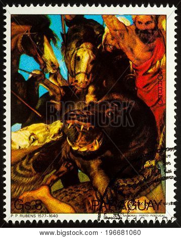 Moscow Russia - July 23 2017: A stamp printed in Paraguay shows painting Hippopotamus hunt by Rubens (detail) series