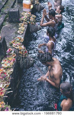 BALI, INDONESIA - MAY 5, 2017: Holy Spring Water Tirta Empul Hindu Temple , Bali