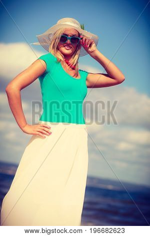 Clothes people summer concept. Pretty woman wearing nice clothing. Lady has turquoise top and white dress.