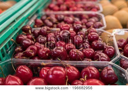 Organics Cherry In Plastic Boxes Sold At  Local City Market. Provence. France