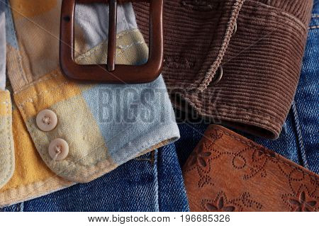 Sleeve shirt and accessories on blue jeans.