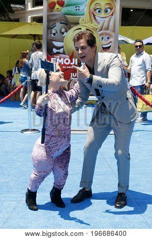 LOS ANGELES - JUL 23:  Tara Jole, Jake T Austin at