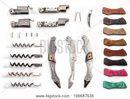 Several Wine corkscrew bottle opener (Spread out on spare parts) on white background.