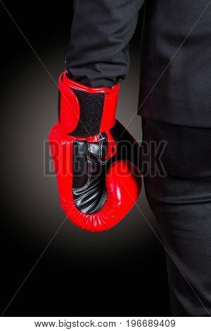 Hands of boxing gloves with a black background.