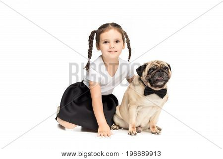 Little Happy Adorable Girl Hugging Pug Dog In Bow Tie, Isolated On White