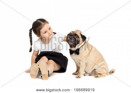 Little Happy Adorable Girl Playing With Pug Dog In Bow Tie, Isolated On White