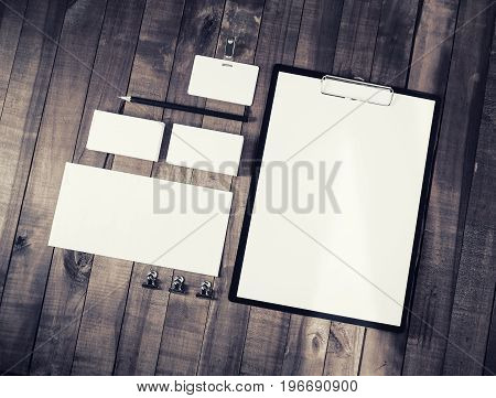 Photo of blank stationery set on vintage wood background. ID template. Mock up for branding identity. Top view.