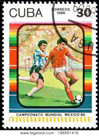 UKRAINE - CIRCA 2017: A postage stamp printed in Cuba shows Football Player's from series FIFA World Cup 1986 - Mexico circa 1986