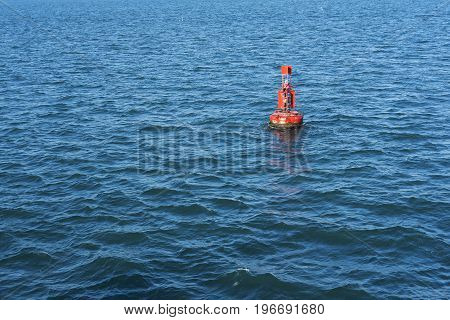 Lonely lighthouse buoy in a beautiful blue sea