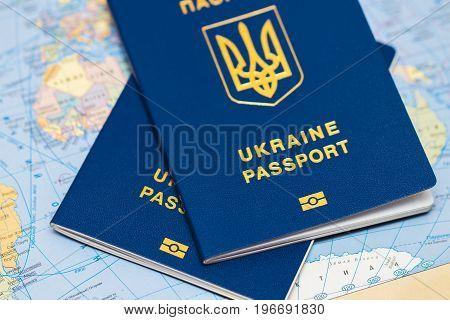 Ukrainian Travel Passport On A World Map