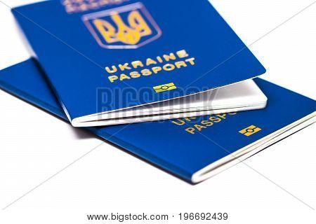 Foreign Passport Of Ukraine Isolated On White Background. Ukrainian Traveler. The Ukrainian Migrant.