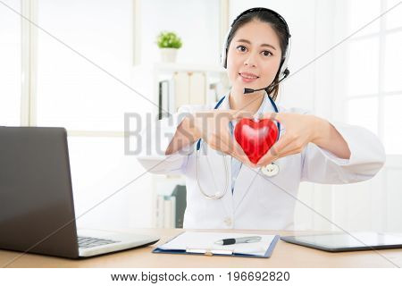 Smiling Female Doctor Working At Personal Office