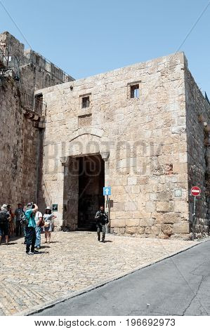 Jerusalem Israel July 14 2017 : Tourists visiting and photographing the Zion Gate in the old city of Jerusalem Israel