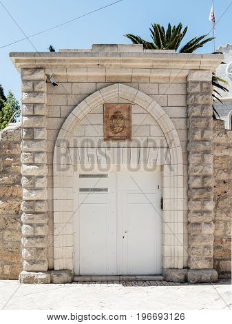 Jerusalem Israel July 14 2017 : The gate of the Franciscan monastery near to the Zion Gate in the old city of Jerusalem Israel