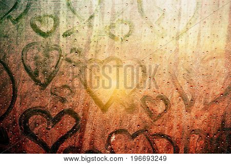 Heart and water drops on glass with of art.