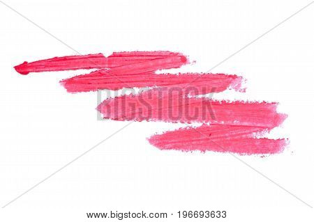 Red lipstick smudge isolated on white background. Smudged makeup product sample