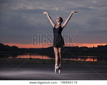 Ballerina on the streets. Ballerina out of doors, young modern ballet dancer posing.