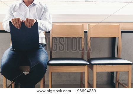 interview recruitment concept Businessman holdind portfolio report while sitting on chair. Tired of waiting Human Resources Waiting for interview.