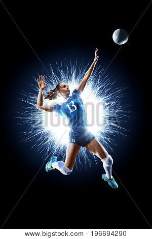Female professional volleyball player isolated on black background