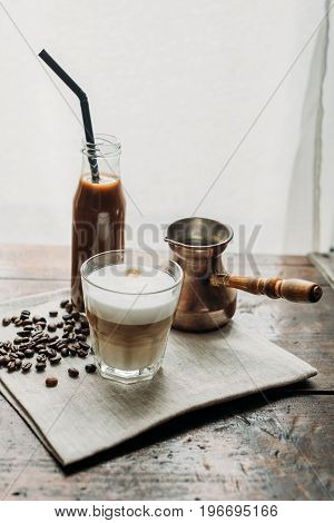 Turkish Coffee Pot, Jar Of Coffee Drink With Tube And Glass Of Cappuccino With Cocoa Powder On Napki
