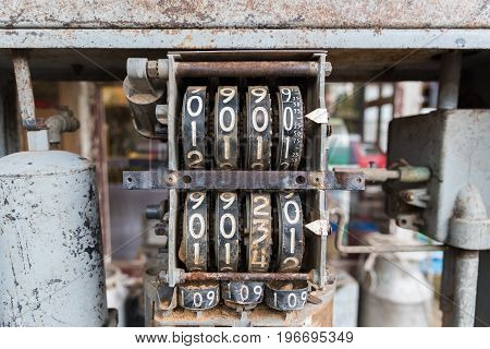 Close up detail of old analog oil measurement. meter dials counter.