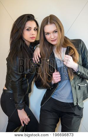 Portrait of two playful women posing in casual clothes