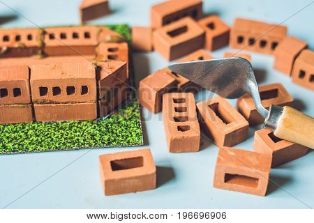 Real Small Clay Bricks At The Table. Early Learning. Developing Toys. Construction Concept